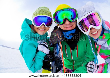 funny portrait of  group snowboarders in winter mount