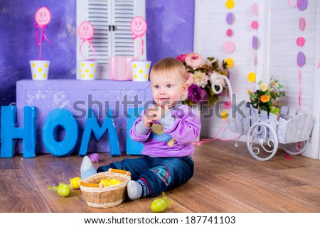 Funny portrait of happy child playing with Easter eggs
