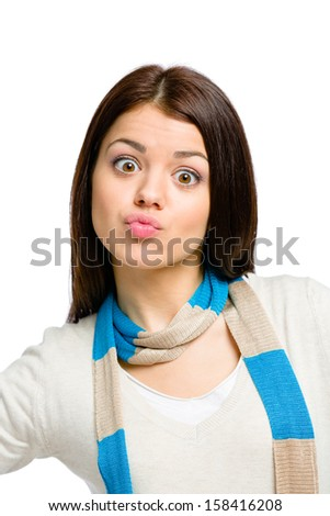 Funny portrait of teenager wearing colored scarf and beige pullover, isolated on white - stock photo