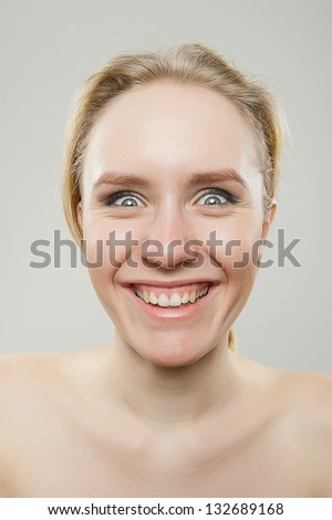 funny portrait of young happy woman smiling creepingly, dorky silly funny face concept - stock photo