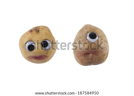 Funny potatoes with eyes and mouth