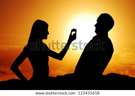 Funny proposal scene with happy woman and man. - stock photo
