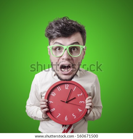 funny puppet business man holding clock on green background - stock photo