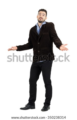 Funny puzzled fashionable man shrugging and smiling at camera. Full body length portrait isolated over white studio background. - stock photo