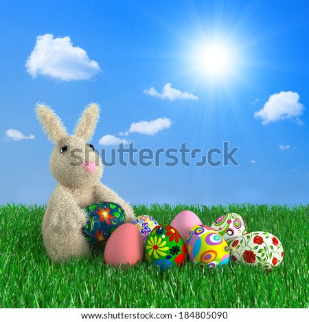Funny rabbit with Easter eggs on a green grass.