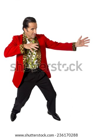 funny rake playboy and bon vivant mature man wearing red casino jacket and Hawaiian shirt standing happy and confident posing attractive gigolo alike isolated on white  - stock photo