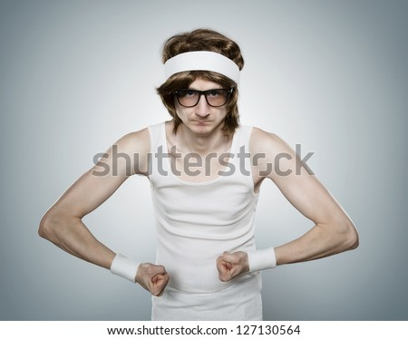 Funny retro nerd flexing his muscle isolated on blue background - stock photo