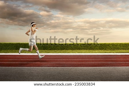 Funny, retro sports nerd jogging on the running track with copy space - stock photo