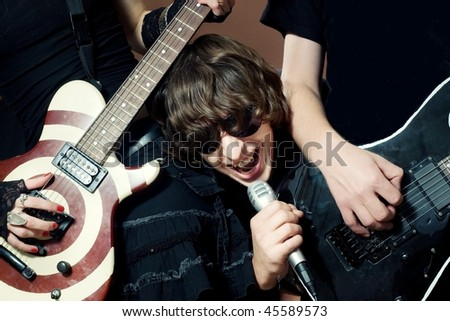 Funny rock singer performance on concert - stock photo