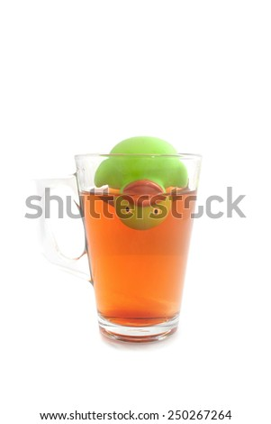 Funny rubber duck upside down in a glass tea isolated on white - stock photo