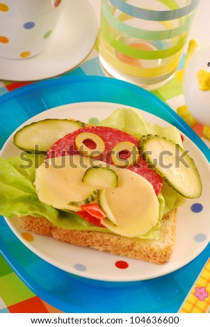 funny sandwich with puppy shape as breakfast for child - stock photo