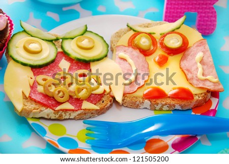 funny sandwiches with owl made from cheese,sausage and vegetables for child - stock photo