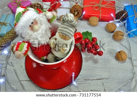 Funny Santa Claus and a boy in a red cup - Christmas decoration