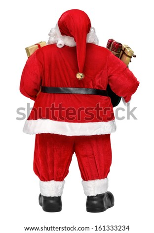 Funny Santa Claus doll with presents - back view, isolated on white background - stock photo