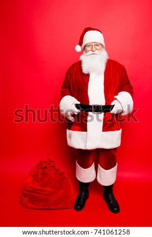 Funny santa in headwear, costume, white gloves brings a lot of gifts for kids, ready, prepared, sale promotion concept. Holly jolly x mas festive noel miracles and magic time! Bag on the floor