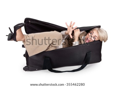 Funny scared girl in a business suit and a large bag of
