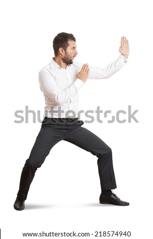 funny screaming businessman standing in pose as karate. isolated on white background - stock photo