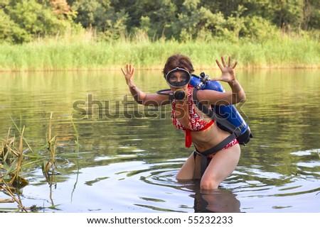 funny scuba diver young woman summer river - stock photo