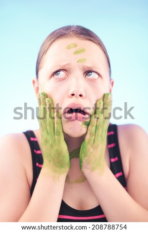 Funny silly dirty teen girl grimacing - stock photo