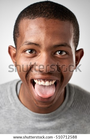 funny silly face expression of real person having fun isolated in studio