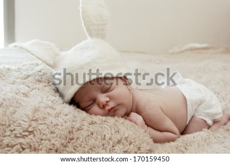 Funny sleeping newborn child - stock photo