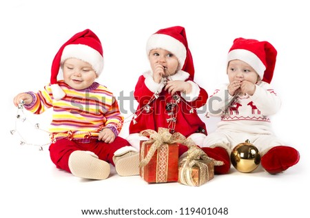 funny small kids in Santa Claus - stock photo