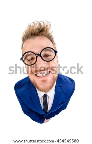 Funny smart guy in a suit and spectacles sugary smiles into the camera. Isolated over white. - stock photo