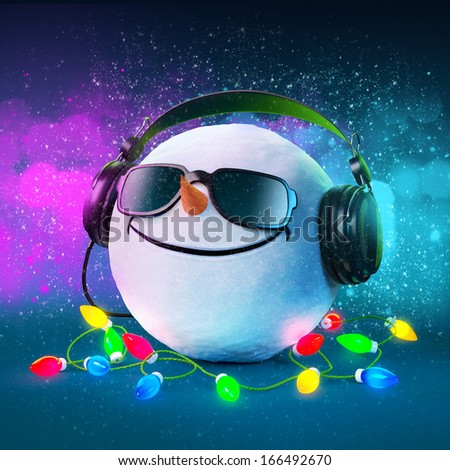 Funny snowball in the headphones. Christmas party. Musical Background  - stock photo