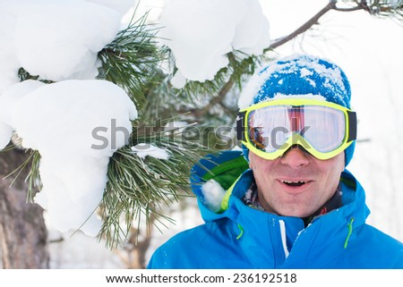 Funny snowboarder in winter forest - stock photo