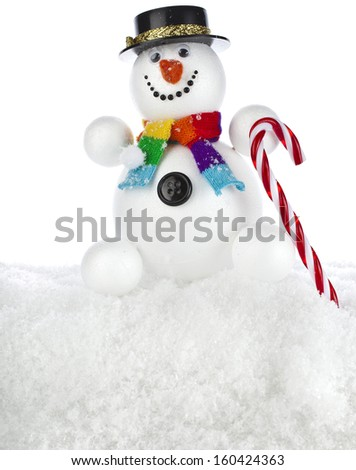 funny snowman with black hat and a striped stick in his hand isolated on white background