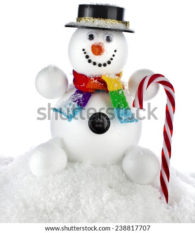 funny snowman with black hat and striped stick in his hand isolated on white background