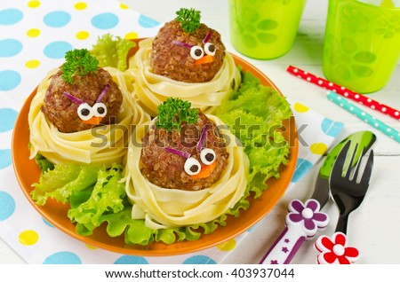 Funny spaghetti with meatballs for kids. Birds in nests - stock photo