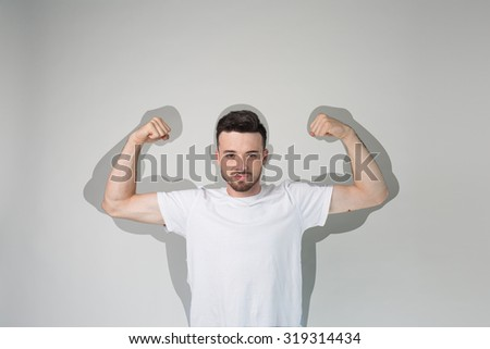 Funny sport man with huge, fake, muscle arms drawn on graphics shadow