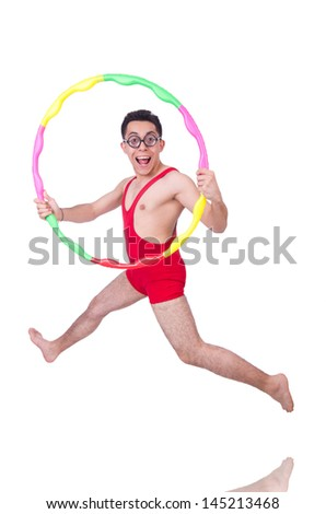 Funny sportsman with hula hoop on white - stock photo