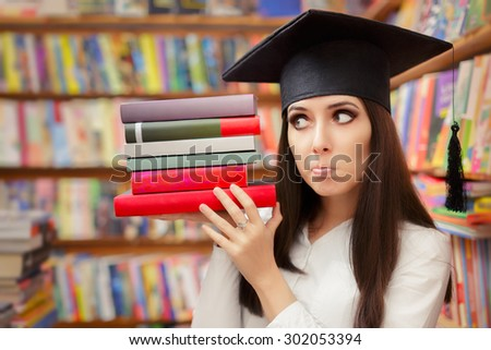 Funny  Student with Graduation Cap Holding Books - School graduate girl in a library holding her textbooks  - stock photo