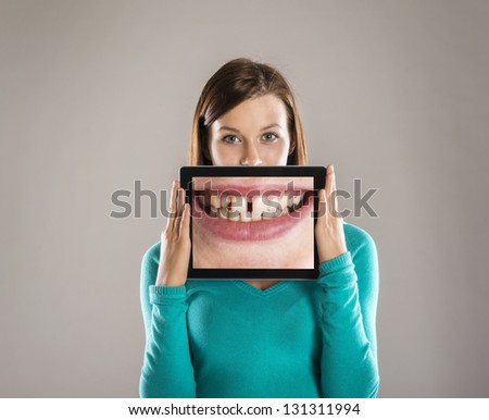 Funny studio portraits with tablet on isolated background - stock photo