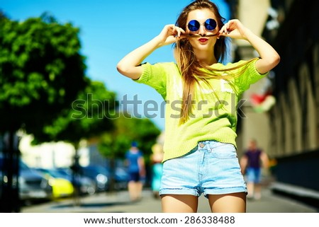 Funny  stylish sexy smiling beautiful young woman model in summer bright yellow   hipster cloth in the street - stock photo
