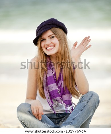 Funny teen girl near the sea. - stock photo