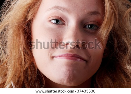 Funny teen girl portrait isolated on black