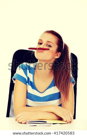 Funny teenage woman doing mustache from pen