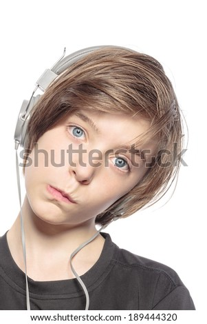 funny teenager boy with earphones, isolated on white. - stock photo