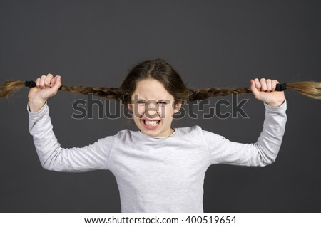 funny teenager girl mad about school with blackboard background - stock photo