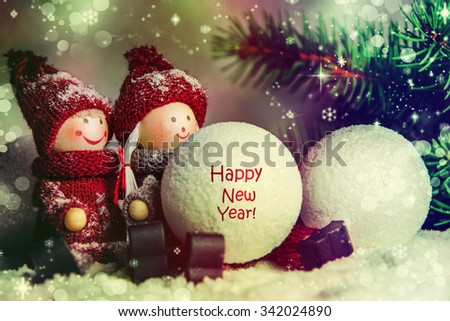 Funny toys are playing in the snow. Christmas Tale. - stock photo