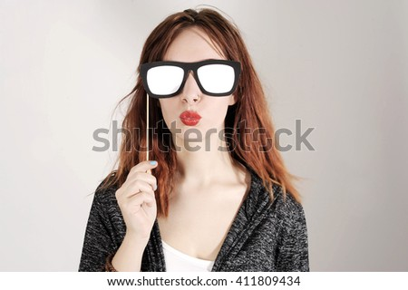 funny trendy fashion girl with paper glasses playing with emotion
