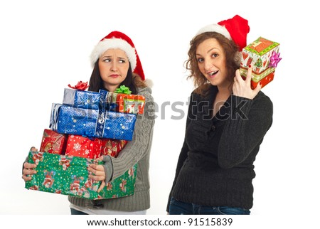 Funny two women holding Christmas gifts isolated on white background - stock photo