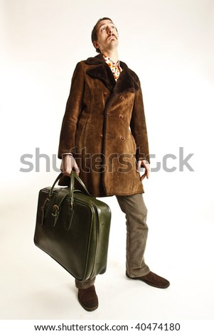funny vintage young man with suitcase - stock photo