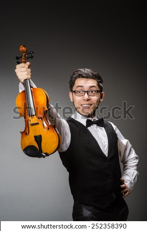 Funny violin player with fiddle - stock photo