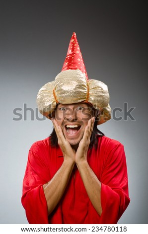 Funny wizard wearing red dress - stock photo