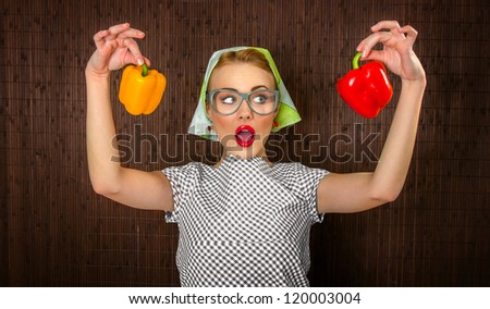 Funny woman cook holading sweet pepper, close up - stock photo