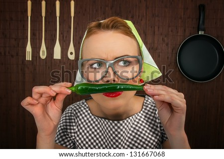 Funny woman cook with hot pepper-close up - stock photo
